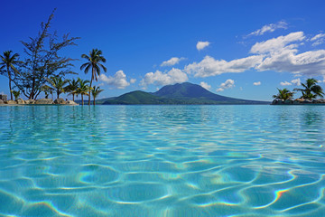 View of the Nevis Peak volcano from a swimming pool in Christopher Harbour, St Kitts  Wall mural