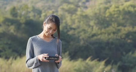 Woman control and remote drone