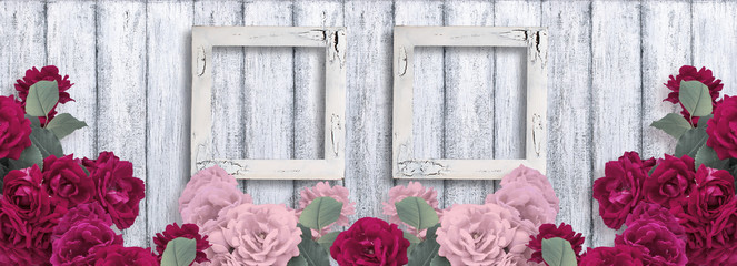 Banner with roses and two empty photo frames on background of shabby wooden planks in rustic style