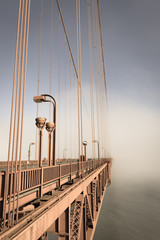 Fog over  Golden Gate Bridge. San Francisco. Part of the famous Golden Gate Bridge. The ocean coast near San Francisco, California.