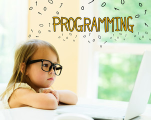 Programming text with little girl using her laptop