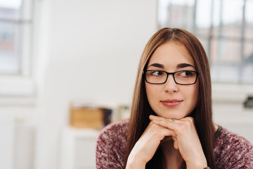Thoughtful businesswoman wearing glasses
