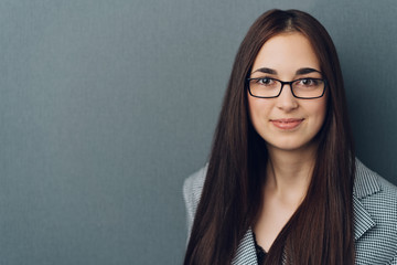 Stylish young professional woman with glasses
