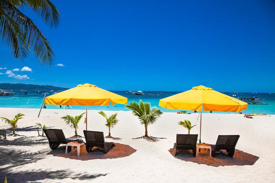 Tropical vacation , sun, blue sky and palm tree on White beach at Boracay, Philippines.