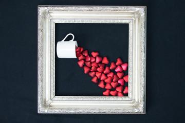 Framed cup spilling hearts