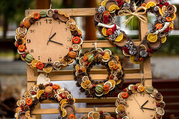 Decorative clock with dried aromatic fruits and vegetables.