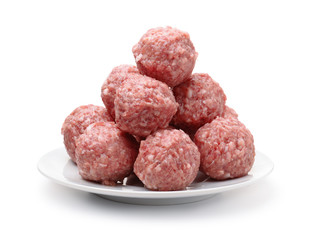 Heap of fresh raw meatballs on plate