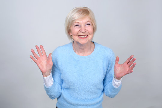 Happy cheerful woman. Senior woman 70 years of age.