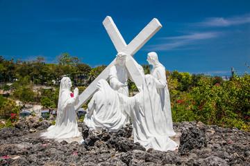 Hrist with pilgrims sculpture in Celestial Garden at Banawa Hills, Cebu. Philippines