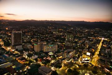 Fototapete - Panorama of Cebu city in sunset,  Philippines.
