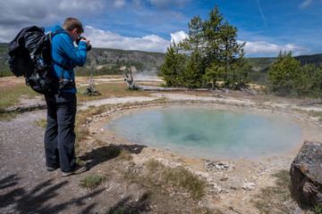 Man photographing Gem Pool