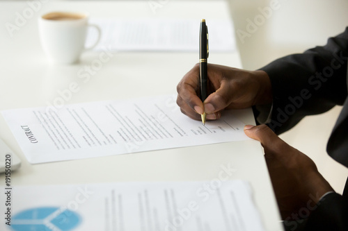 African American Businessman Agree To Make Deal Signing Business - Signing legal documents