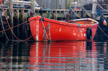 Bright Red Fishing Dory Tied to Dock