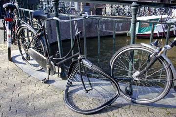 Broken Bicycle on the Side of a Canal in Amsterdam, Netherlands