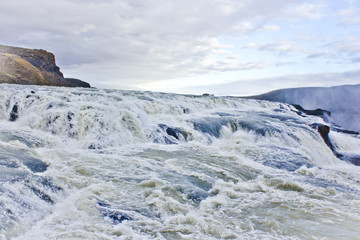 Closeup of the Rushing Waters Falling Down the Rocks of Gullfoss Waterfall in Iceland