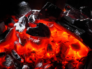 Closeup of charcoal burning.Burning charcoal texture