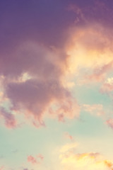 The vertical view of sky background or texture at the sunset time with clouds. Copy space