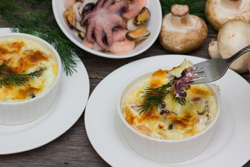 Julienne with mushrooms and seafood: octopus, mussels.