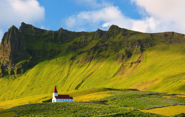 Beautiful Red Church on a Mountain Top at Vik, Iceland.