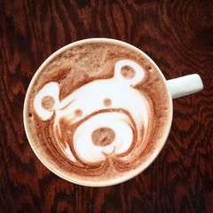 Cute teddy bear drawing on hot chocolate cup