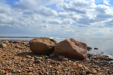 two large stones on the shore