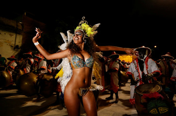 Members of a comparsa, an Uruguayan carnival group, participate in the Llamadas parade, a street fiesta with traditional Afro-Uruguayan roots, in Montevideo