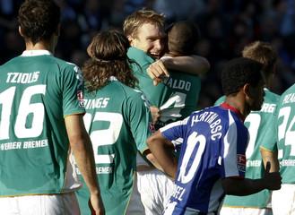 Werder Bremen's Mertesacker celebrates with team mates after he scored a goal against Hertha Berlin during their German Bundesliga soccer match in Berlin