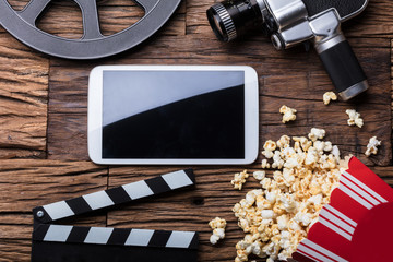Elevated View Of Smartphone And Spilled Popcorn