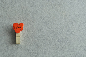 The word plus on a peg isolated on a white background