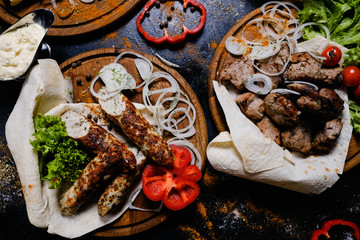 shashlik and kebab assortment food. Grilled meat with vegetables and lavash. Traditional Armenian dish