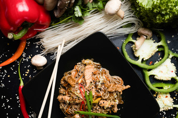 rice noodle beef and vegetable dish recipe. meal food ingredients and cooking process. asian cuisine