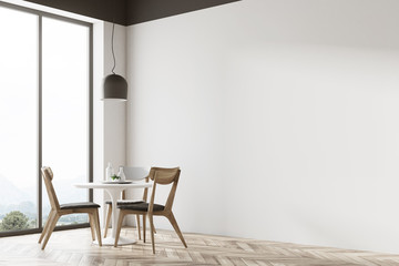 White round table in a cafe corner