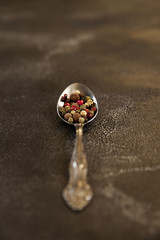 peppercorns in a spoon, black pepper, red pepper, fragrant pepper
