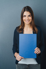 Happy confident young woman holding her CV