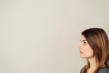 Serious young woman looking at blank copy space