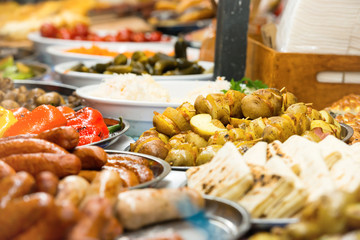 Food street festive of traditional asian cuisine with vegetables, meat and sausage on market