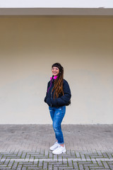 Portrait of an Urban Young Woman with Dreadlocks