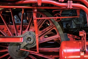 old steam locomotive wheel closeup - old transport technology