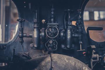 vintage technology - valves and handles inside old machine