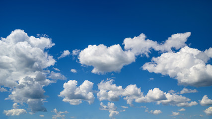 Bright summer blue sky with white clouds.