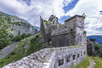 Zelfklevend Fotobehang Vestingwerk St John Fortress remains on a mountain in Kotor, Montenegro