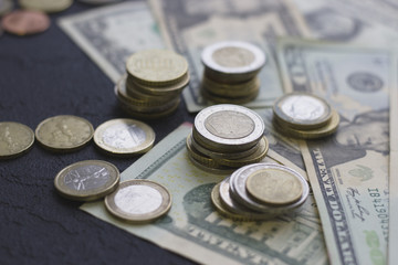 Coins and paper United States money on the table. Euro coins. USA money. Euro currency. Money concept. Closeup