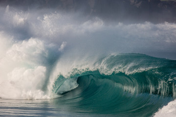 dramatic stormy wave breaking  in waimea bay, hawaii on the north shore of Oahu.  Wall mural