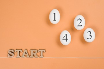 Abstract image. The word start and eggs on the way from start to finish