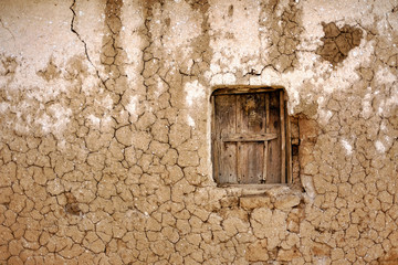 Clay house with wooden window in Africa hit by drought Wall mural