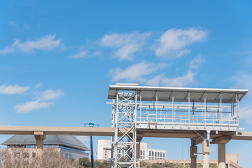 Light rail system station under construction in Las Colinas, Irving, Texas, USA. Elevated  Area Personal Transit (APT) automated peoplemover system platform blue sky.
