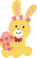 イースターエッグを抱えるウサギのイラスト