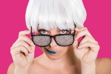 Provocative girl in diamond glasses