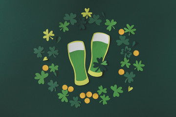 top view of paper decoration of green beer for st patricks day isolated on green