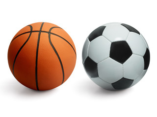 Basketball and football balls isolated on white background